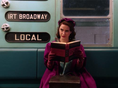 Mrs. Maisel reading on the subway.