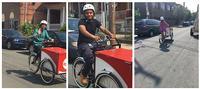 Lucien E. Blackwell West Philadelphia Regional Library staff riding Book Bike around the neighborhood.