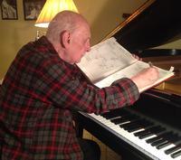 George Crumb working at his piano, 2013. Photo credit: Margaret Leng Tan