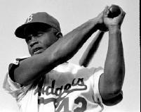 Jackie Robinson swinging a bat in Dodgers uniform, 1954.