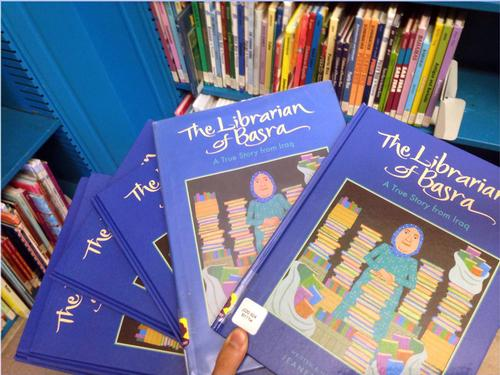 Just a few of the many copies of The Librarian of Basra we've got for you to check out