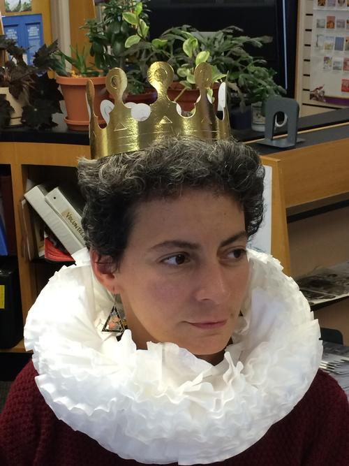 Wadsworth Library's supervisor models one of the ruffled collars.