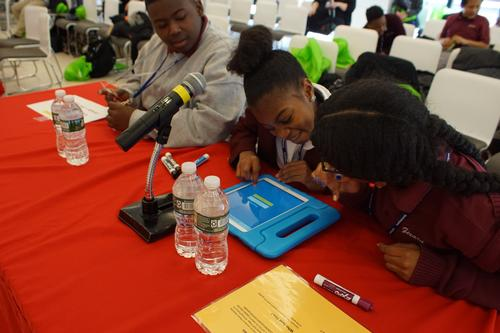 Teams of sixth graders from three Philadelphia schools used iPads to buzz in and answer literature questions.