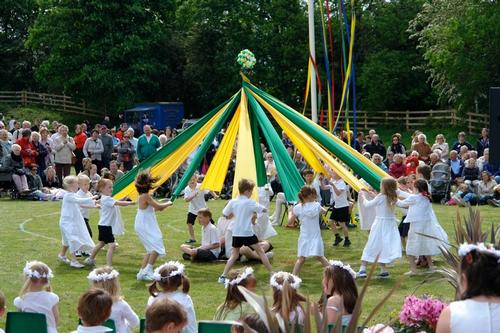 Children perform a ribbon dance around a maypole in Barwick-in-Elmet, England, c. 2011.