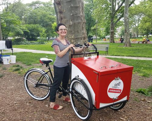 Children's Librarian Link Ross rides over to Clark Park in West Philly with the brand new Book Bike