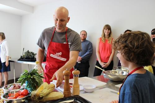 Marc Vetri works with a budding young chef.