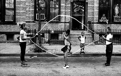The Brooklyn of <i>Another Brooklyn</i> also calls back to another era—one filled with jump rope, jacks, chasing ice cream trucks, and dancing in fire hydrants.