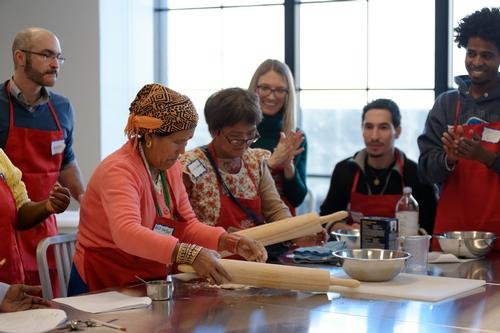 A previous Edible Alphabet class rolling out dough.