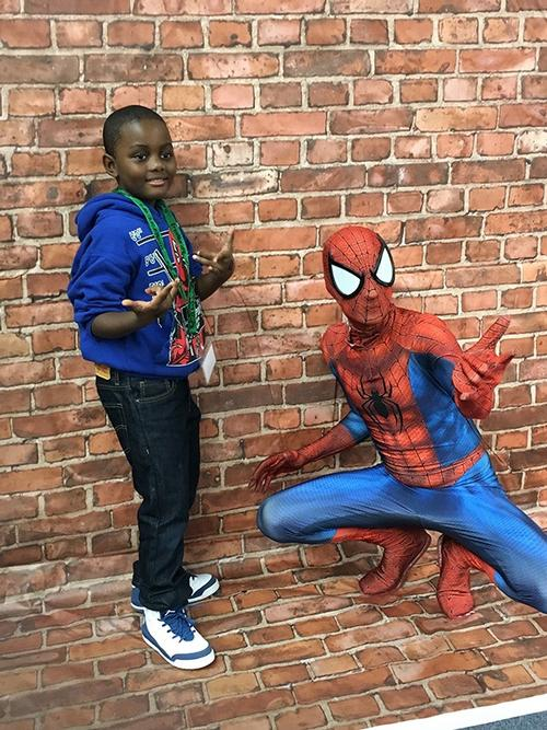 It's Your Friendly Neighborhood Spider-man, hanging out with one of our Comic Con attendees!