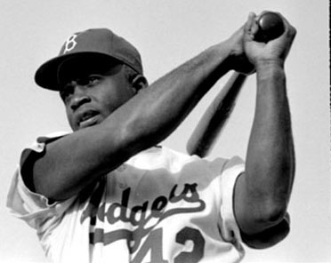 Jackie Robinson swinging a bat in Dodgers uniform, 1954.