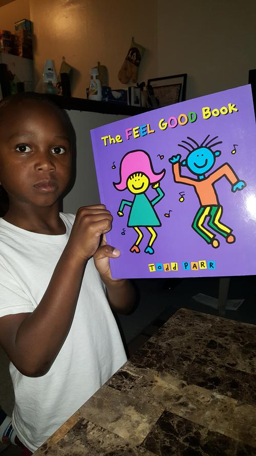 Maurice shows off a book he got at the September Words at Play Block Party.
