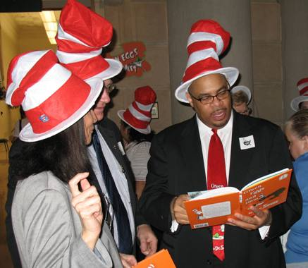 Michael Marks of the National Education Association Executive Committee rehearses a dramatic reading of Green Eggs and Ham to warm up the crowd.