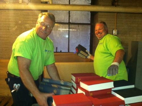 Volunteers from PECO help move library materials in the stacks.