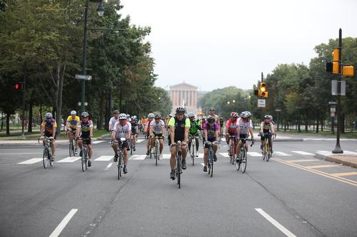 Bikers cruise down the Benjamin Franklin Parkway.