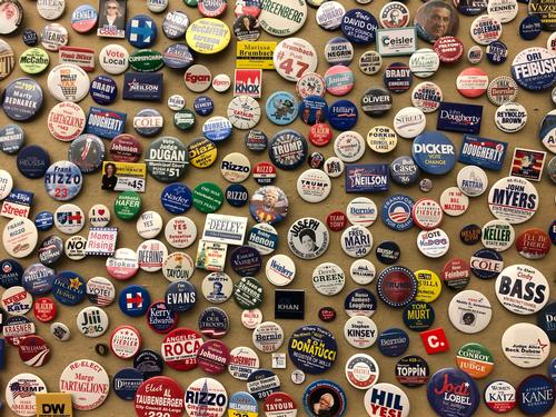 Buttons from campaign trails, on display at the County Board of Elections in City Hall.