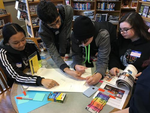 Teens working on a design for the library.