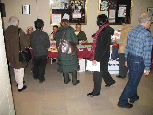 Attendees Browse the Information Booths