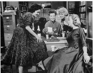 Katharine Hepburn (center) as Bunny Watson, reference librarian, in the 1957 film Desk Set