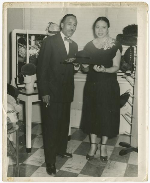 Mae Reeves and her husband Joel pose with her hats at Mae's Millinery in Philadelphia, circa 1953. Collection of the Smithsonian National Museum of African American History and Culture, Gift from Mae Reeves and her children, Donna Limerick and William Mincey, Jr.