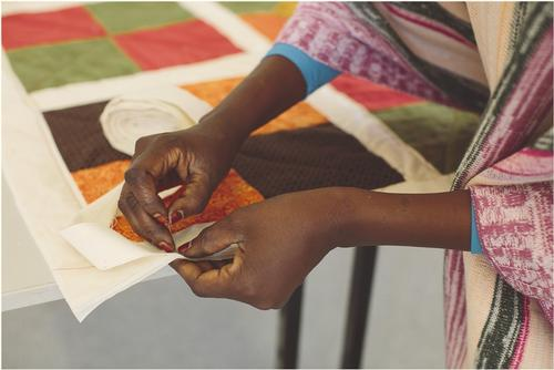 Exchanging and quilting stories in our journey together.