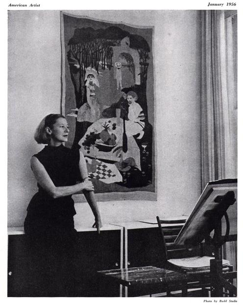 This photo of Evaline Ness at home in her apartment, in front a tapestry she made herself, is from <i>American Artist</i> magazine, January 1956.