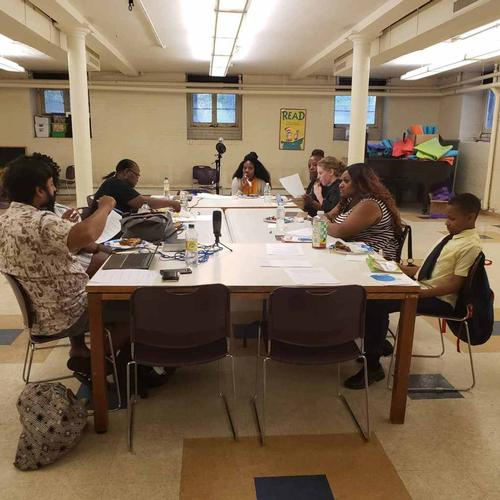 From left to right: Andrew Blassingame, Andrea Blassingame, Adrienne Harwell, Pat Erwin, Lapina Burris, Shirley Reynolds, Terica Green, and Neil Bardhan discuss ways to promote literacy in Southwest Philadelphia.