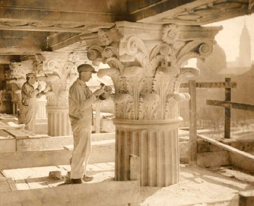Stone carvers working on the exterior.