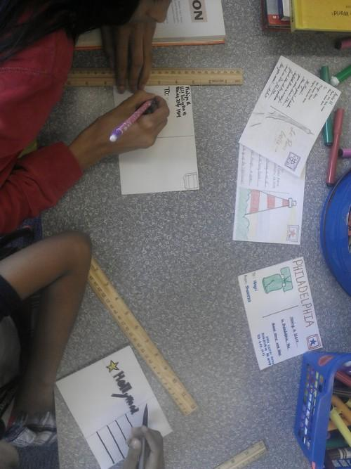 Children make travel postcards at Roxborough Library.