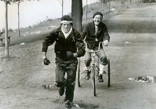 Burgess Meredith bikes to whip Sylvester Stallone into shape. Why don't you? (Image via Rides a Bike.)