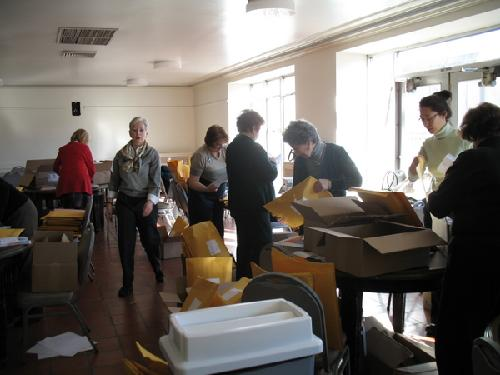 One Book Committee Members Prepare Reading Materials for Community