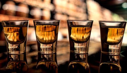 whiskey in shotglases