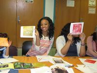 Angelina shows off her creation during an afterschool PAFA printmaking workshop.