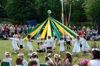 Children perform a ribbon dance around a maypole in Barwick-in-Elmet, England, c. 2011.