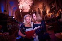 Guests enjoying the treasures of the Library during the event.