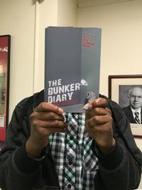 Alex F. holding The Bunker Diary by Kevin Brooks