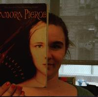 Example of 'BookFace Friday' taken by a student at Science Leadership Academy.