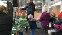 Blowing bubbles at Christmas Village Storytime