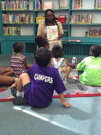 Christina reading to children during a storytime event.
