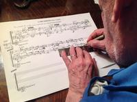 George Crumb writing out music for