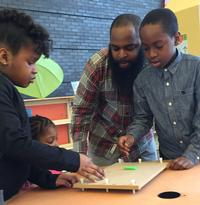 After comparing instrument sounds, families tried out their own sound experiments in a Play Party hosted by the Franklin Institute and the Kimmel Center.