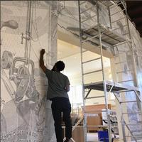 Touching up Ben Volta's <i>Diligence</i> at Tacony Library. Photo credit: instagram.com/benvolta