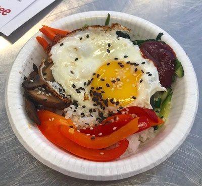Although there are many variations, bibimbap always includes cooked rice, cooked and seasoned vegetables, and Korean fermented red chili pepper paste (gochujang).