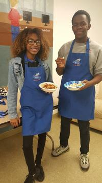 Elba (left) and Amir (right) enjoying a dish they cooked up with Get HYPE Philly!