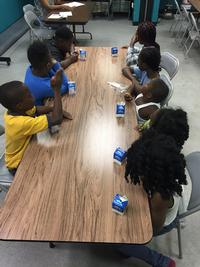 Children eating fresh daily meals, provided through the Summer Food Service Program (SFSP)