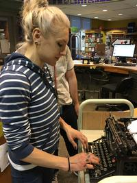 South Philly poet Maria Fama composing first of Fumo Family Library Community Poem