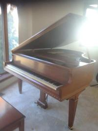 Baby grand piano being donated to the Richmond Library