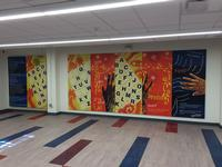 Original artwork created just for Logan Library by Ife Nii Owoo can be viewed in the Community Room on the lower level. The indoor mural, Read: A Pathway for Hope, focuses on the importance of literacy in the community.