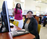 Helping patron with Job Readiness computer resources (photo credit: Philadelphia Inquirer)