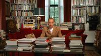 John Waters in his home library