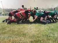 A rugby scrum (in which the author—whose hand can be seen next to the ball—is 'putting in' the ball to initiate play)